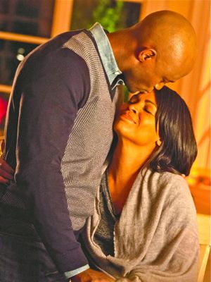 Best Man Holiday's Morris Chestnut bends to kiss wife