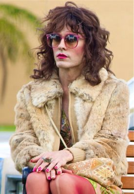 Dallas Buyers Club's Jared Leto dressed in drag sits on car hood