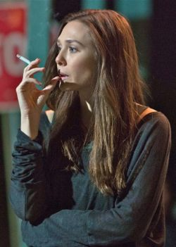 Elizabeth Olsen smoking a cigarette (or weed)