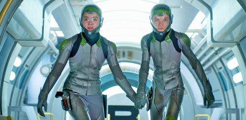 Hailee Steinfeld and Asa Buterfield hold hands as they enter zero-gravity arena