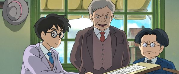 Wind Rises' Jiro looks at aeronautical designs with  boss