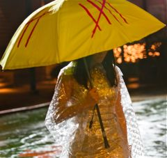 Oldboy's Mystery Woman stands in rain with umbrella