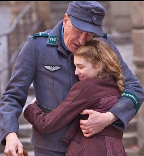 Book Thief's Liesel embraces her papa in street