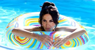 Great Beauty's Sabrina Ferilli floats in pool