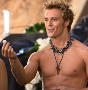 Hunger Games' barechested Sam Claflin holds a sugar cube