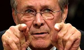 Donald Rumsfeld points fingers at camera
