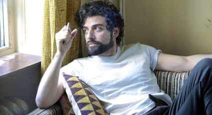 Inside Llewyn Davis' Oscar Isaac gazes out window cigarette in hand