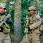 Lone Survivor's Navy SEALS stand in forest