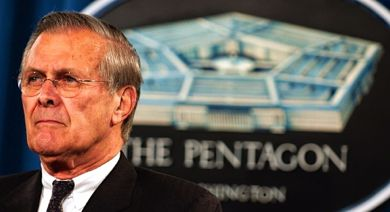 Donald Rumsfeld stands at DOD podium