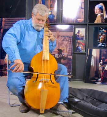 Tim's Vermeer's Tim Jenison plays bass in art studio