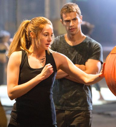 Divergent's Theo James watches Shailene Woodley hit punching bag
