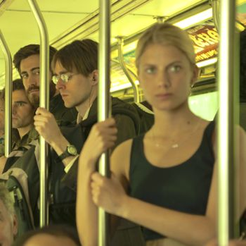 Enemy's Melanie Laurent stands in a bus