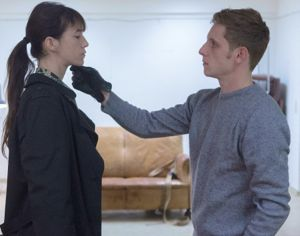 Nymphomaniac's Jamie Bell lifts Charlottte Gainsbourg's chin with gloved hand