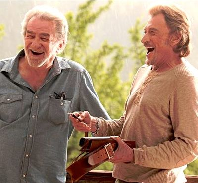 Salaud on t'aime's Eddy Mitchell and Johnny Hallyday share a laugh