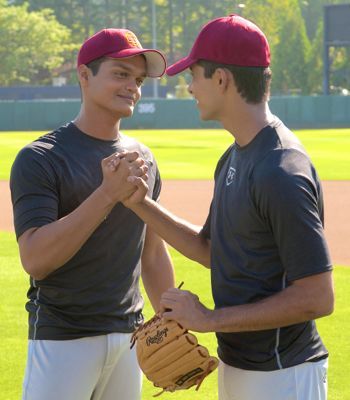 Million Dollar Arm's Madhur Mittal and Suraj Sharma embrace on field