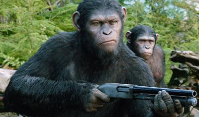 Dawn of the Planet of the Apes' Andy Serkis' Cassar points a rifle