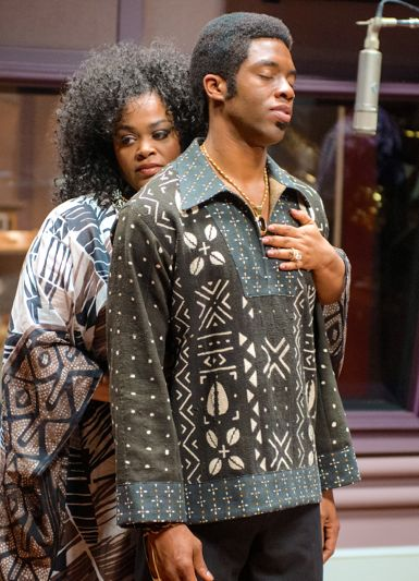 Get on Up's Jill Scott hugs Chadwick Boseman from behind