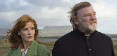 Calvary's Brendan Gleeson and Kelly Reilly gaze at sea from a cliff