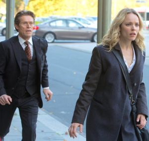 Most Wanted Man's Willem Dafoe pursues Rachel McAdams down a street