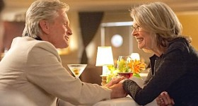And So It Goes' Michael Douglas and Diane Keaton hold hands at restaurant table