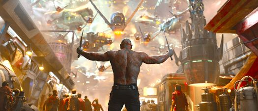 Dave Bautista's Drax the Destroyer faces enemy forces with his weapons in hand