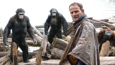 Dawn of Planet Apes' Jason Clarke confers with the ape leaders