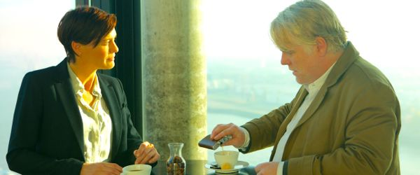 Most Wanted Man's Robin Wright and Philip Seymour Hoffman share coffee at standup table