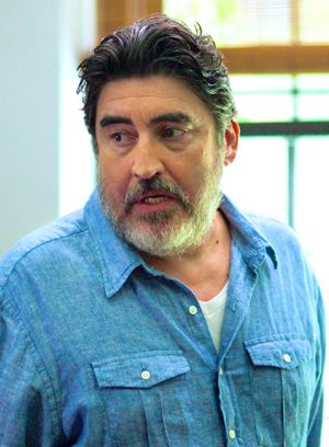 Love is Strange's Alfred Molina looks away from window