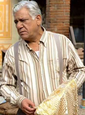 Om Puri oversees his restaurant's nightly set-up