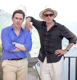 Trip to Italy's Steve Coogan and Rob Brydon pose on seaside balcony