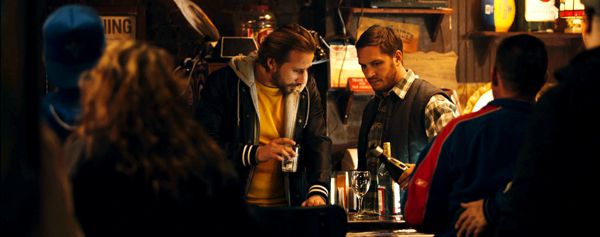 Drop's Matthias Schoenaerts drinks next to Tom Hardy in bar