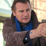 Walk Among Tombstone's Liam Neeson points hand gun