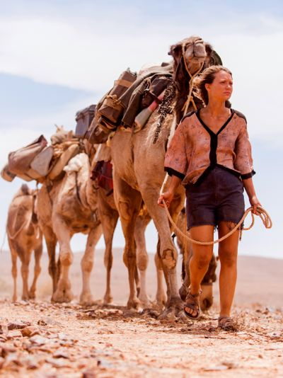 Track's Mia Wasikowska leads 4 camels in desert