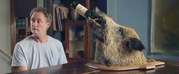My Old Lady's Kevin Kline plays piano on which sits a boar's head