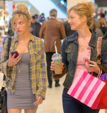 Men Women Children's Olivia Crocicchia and Judy Greer walk in mall