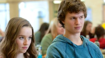 Men Women Children's Kaitlyn Dever and Ansel Elgort sit beside each other in classroom