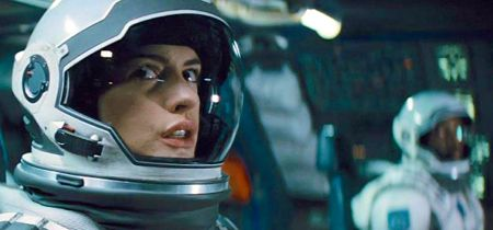 Interstellar's Anne Hathaway sits in space craft and gazes out window