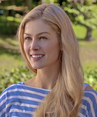 Gone Girl's Rosamund Pike looks left and smiles