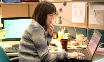 Men Women Children's Rosemarie DeWitt sits at laptop keyboard