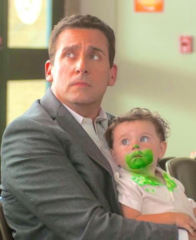 Steve Carell holds baby with green marker on her face