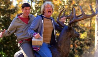 Dumb and Dumber To's Jim Carrey and Jeff Daniels ride on a deer statute