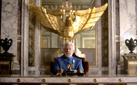 Hunger Games' Donald Sutherland sits at presidential table looking smugly