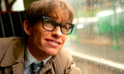 Theory of Everything's Eddie Redmayne looks happily out of rail car window
