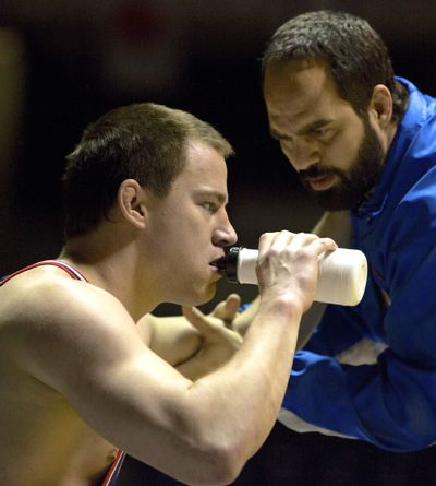 Foxcatcher's Mark Ruffalo coaches Channing Tatum at wrestling match