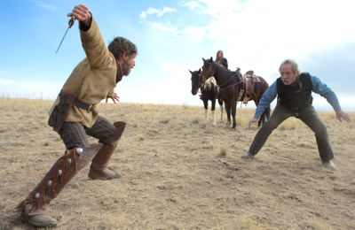 Homesman's Tim Blake Nelson and Tommy Lee Jones fight with fists and knife in desolate plains
