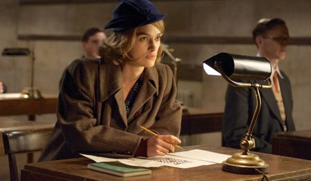 Imitation Game's Keira Knightley does crossword puzzle at a desk