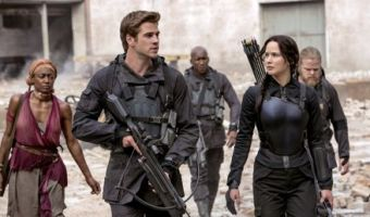 Hunger Games' Liam Hemsworth and Jennifer Lawrence walk about destruction from war