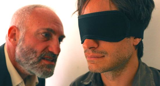 Ken Bodnia's Rosewater leans close to blindfolded Gael Garcia Bernal