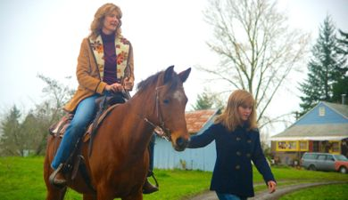 Wild's Reese Witherspoon leads Laura Dern sitting on a horse