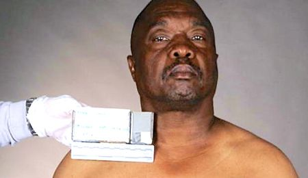 Tales of Grim Sleeper's booking photo for killer Lonnie Franklin